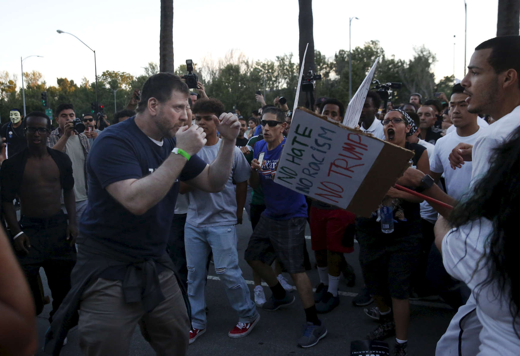 Eric Zarahn, a Trump supporter, gets in a fighting position after getting in a tiff with anti-Trump protesters after they surrounded him and snatched his hat off of his head near the convention center where presidential candidate Donald Trump held a campaign rally June 2, 2016 in downtown San Jose, Calif.