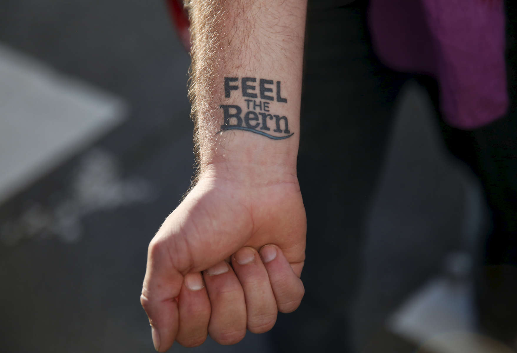Christopher Ray of San Francisco shows off his Bernie Sanders tattoo during a Hillary Clinton fundraising protest in Nob Hill April 15, 2016 in San Francisco, Calif. The fundraiser was attended by George Clooney, among others. Dozens of protesters showed up and marched around the block to each entrance where police had set up barricades.