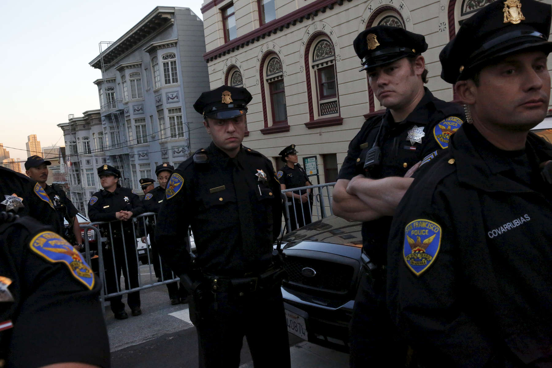 SFPD officers stand guard at a blockade at the end of the street near the entrance to a Hillary Clinton fundraising event in Nob Hill April 15, 2016 in San Francisco, Calif. The fundraiser was attended by George Clooney, among others. Dozens of protesters showed up and marched around the block to each entrance where police had set up barricades.