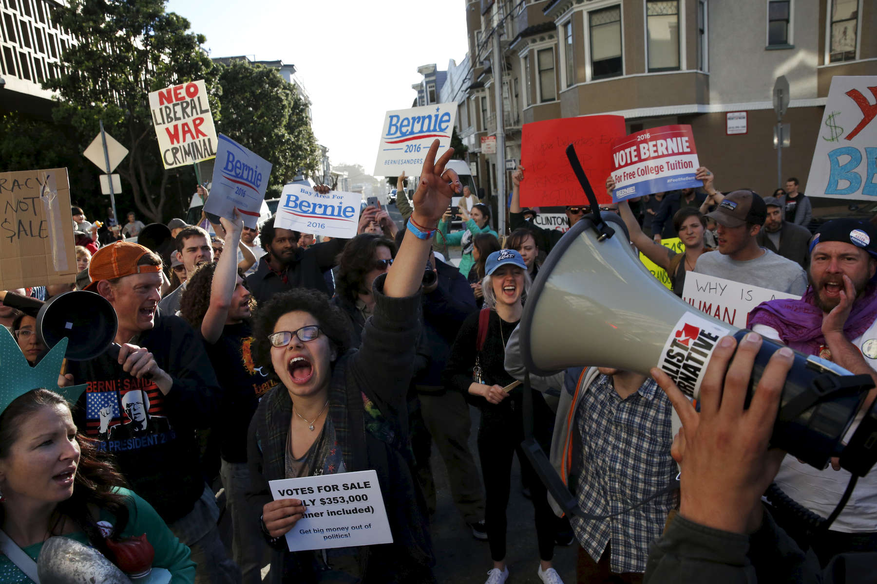 Ellie Koepplinger cheers with other Bernie Sanders supporters during a Hillary Clinton fundraising protest in Nob Hill April 15, 2016 in San Francisco, Calif. The fundraiser was attended by George Clooney, among others. Dozens of protesters showed up and marched around the block to each entrance where police had set up barricades.during a Hillary Clinton fundraising protest in Nob Hill April 15, 2016 in San Francisco, Calif. The fundraiser was attended by George Clooney, among others. Dozens of protesters showed up and marched around the block to each entrance where police had set up barricades.