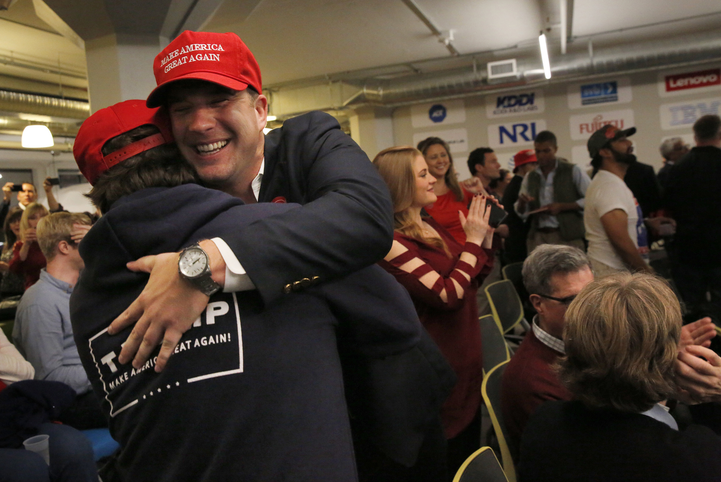 James Wall, left, and Stephen White celebrate as they watch the returns for their candidate during a watch party for Republican Presidential Candidate Donald J. Trump Nov. 8, 2016 in San Francisco, Calif.