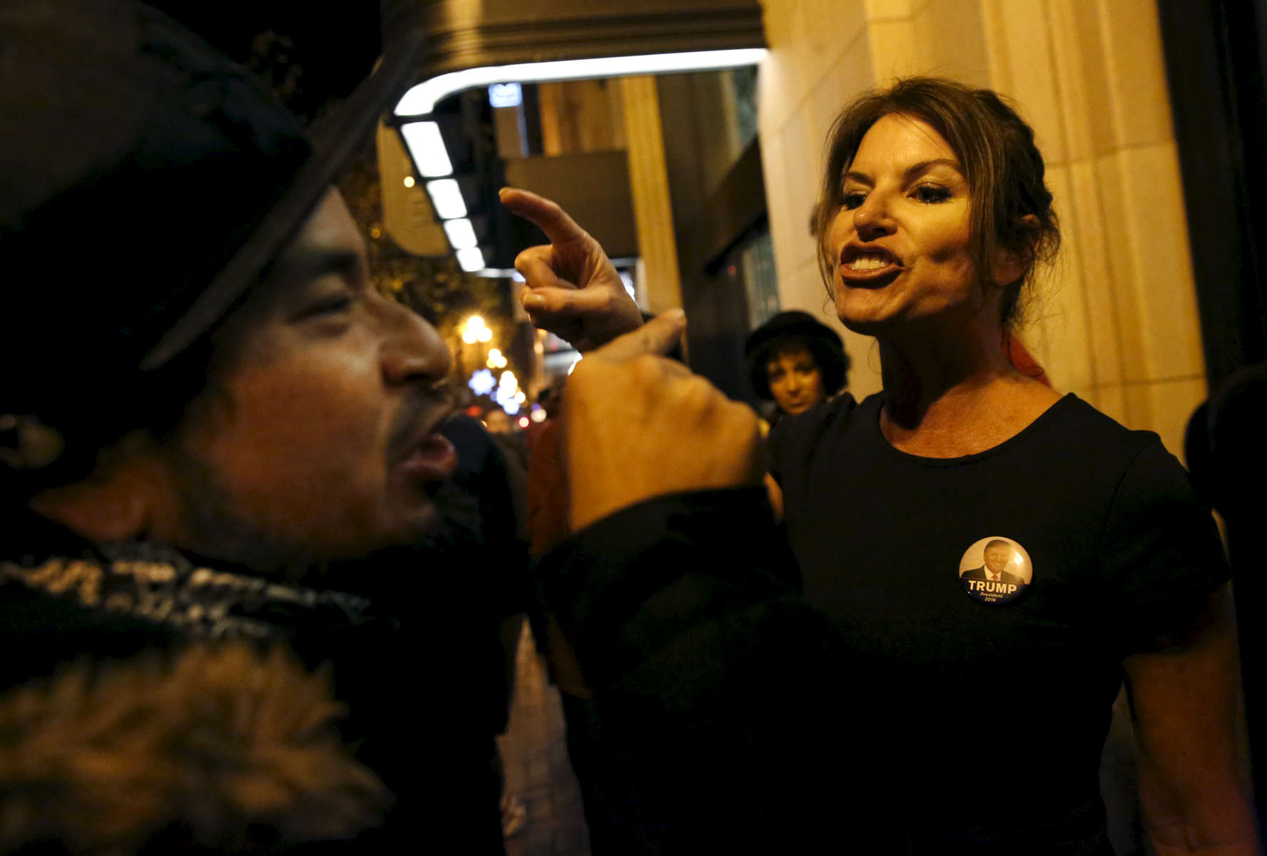 A protester argues with a President Elect Donald Trump supporter after a Republican Presidential candidate Donald J. Trump watch party outside the Twitter building Nov. 8, 2016 in San Francisco, Calif.