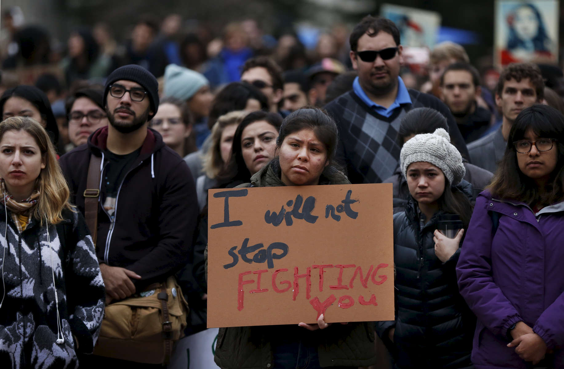 UC Berkeley student Ashley Sandoval, center, listens to a speaker during a planned {quote}J20{quote} walk-out protest at UC Berkeley campus in response to the inauguration of President Donald J. Trump Jan. 20, 2017 in Berkeley, Calif.