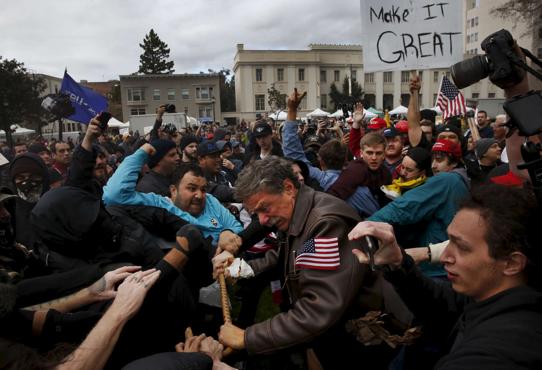 Tom Condon of San Francisco, center, a Trump supporter, becomes entangled in the center of a fight after attempting to push anti-fascist protesters back with his cane during a Pro-President Donald Trump rally and march at the Martin Luther King Jr. Civic Center park March 4, 2017 in Berkeley, Calif.