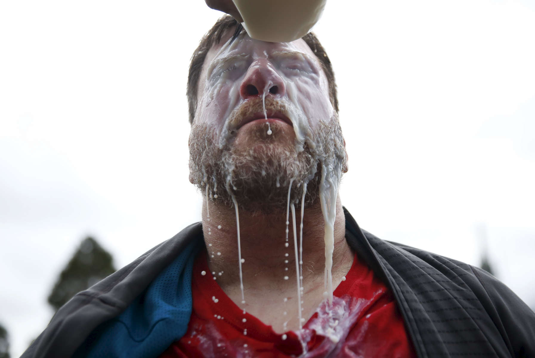 Eric Zarahn, a Trump supporter, gets milk poured on his eyes after getting pepper-sprayed during a pro-President Donald Trump rally and march at the Martin Luther King Jr. Civic Center park March 4, 2017 in Berkeley, Calif.