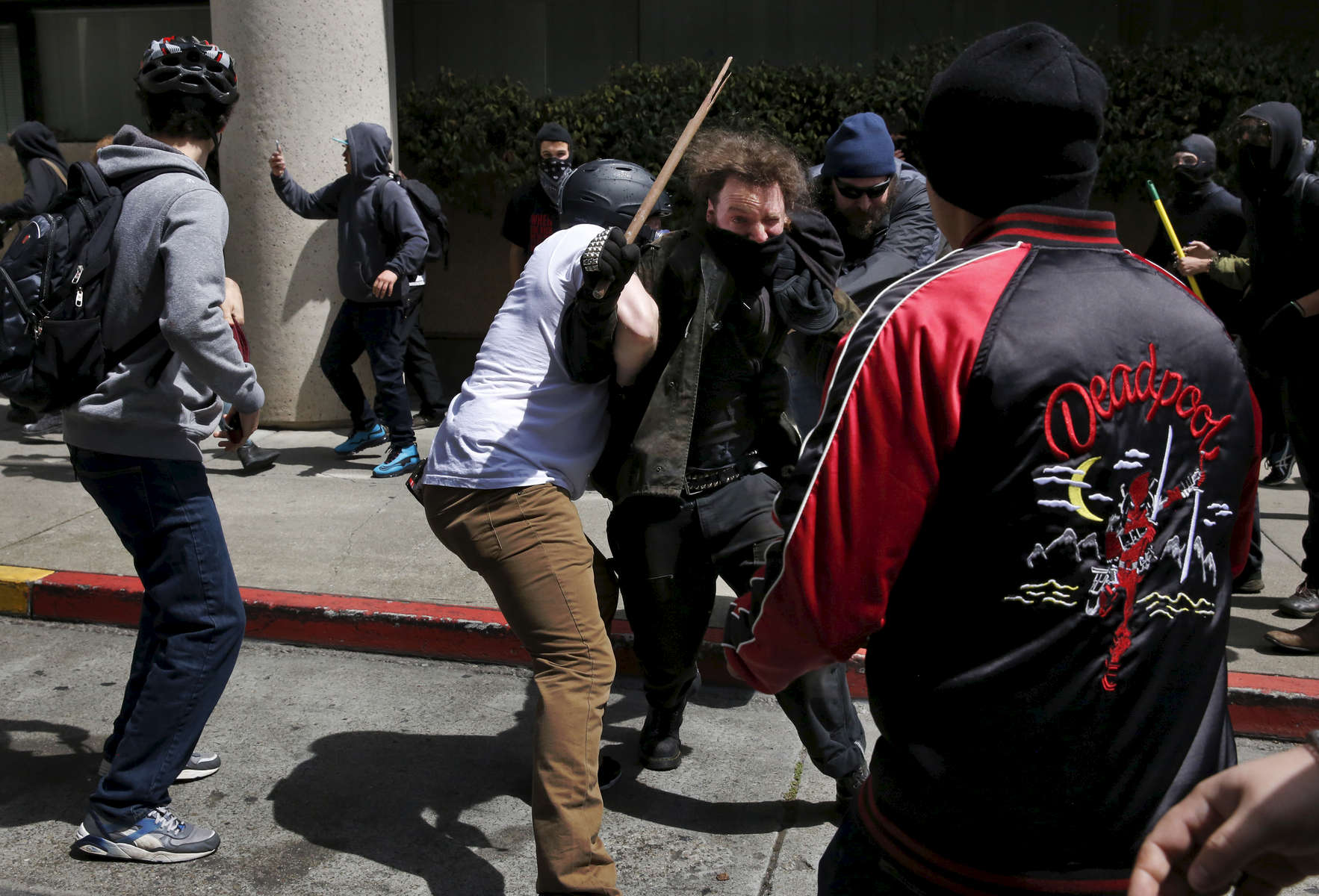 Pro-Trump and anti-fascist protesters brawl in the street on Milvia and Center streets after a rally called {quote}Patriot's Day Free Speech Rally{quote} in Martin Luther King Jr. Civic Center Park turned violent April 15, 2017 in Berkeley, Calif.