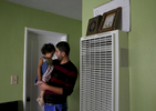 Mohanad Hussien, 23, reassures his daughter Nisreen Hussien, 1, in the family apartment before leaving for a quick smoke break Oct. 20, 2016 in Oakland, Calif. The Syrian family has recently been resettled in Oakland after spending a few years in Jordan after fleeing the Syrian civil war.
