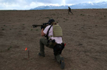 Penny Logue lays down cover fire as J Stanley and Bonnie Nelson run ahead during a live fire drill at their range on the Tenacious Unicorn Ranch in Westcliffe, Colorado. The group say they have stepped up their training since they started receiving death threats and caught armed people on their property.