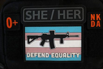 """Several patches on Penny Logue's pouch that surround a """"Defend Equality"""" transgender flag with a rifle outline on it inform strangers or medical personnel of her blood type and no known allergies as well as her pronouns, on the Tenacious Unicorn Ranch."""