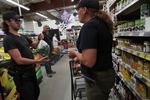 Penny Logue and J Stanley shop for groceries in town in Westcliffe, Colorado.