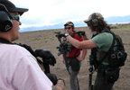 Penny Logue, Bonnie Nelson and J Stanley discuss a live fire drill before executing it together at their range on the Tenacious Unicorn Ranch. The group say they have stepped up their training since they started receiving death threats and caught armed people on their property.