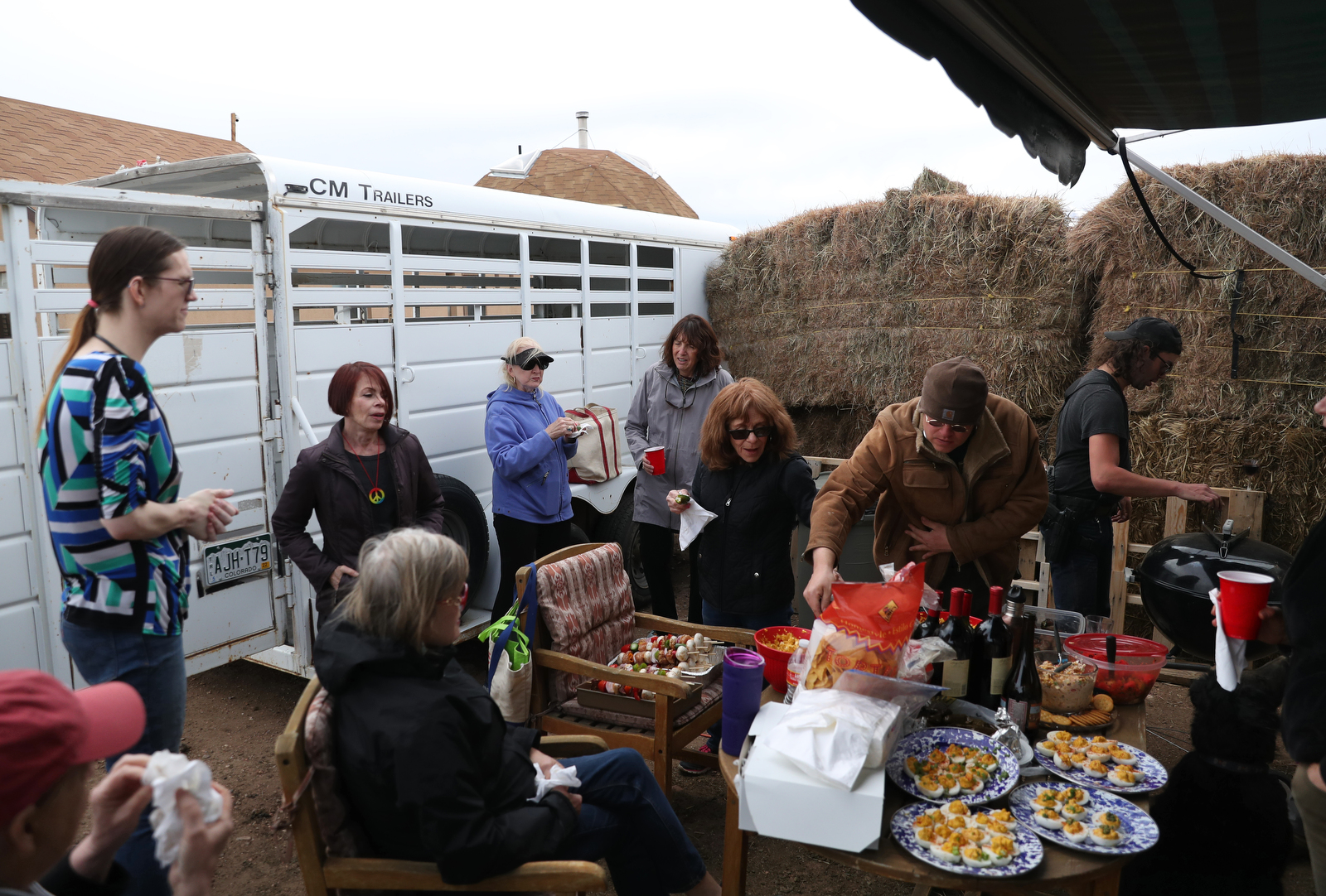 Rancher Jennifer Radford, upper left, mingles with community members and friends, (from left), Cassie Schwartz, Jackie Jones, Ellen Glover, Melissa Salierno along with fellow ranchers Sky Nelson and J Stanley during during a BBQ at the Tenacious Unicorn Ranch.