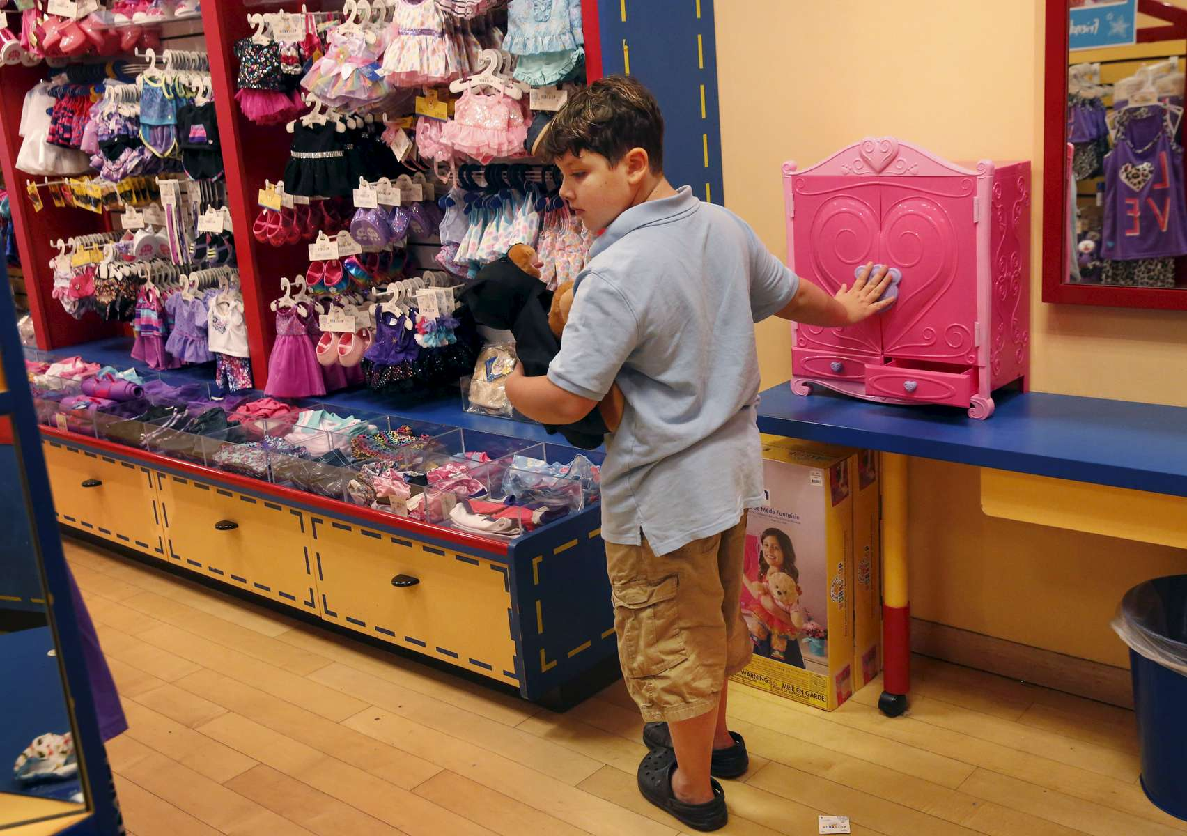 James Kaplan, 8, looks for accessaries for his newly made stuffed dog after finding him a batman costume at Build-A-Bear Workshop in Hillsdale Shopping Center August 11, 2016 in San Mateo, Calif. Sara took both of her children to the store to reward them for doing something physically active every day for 30 days straight.