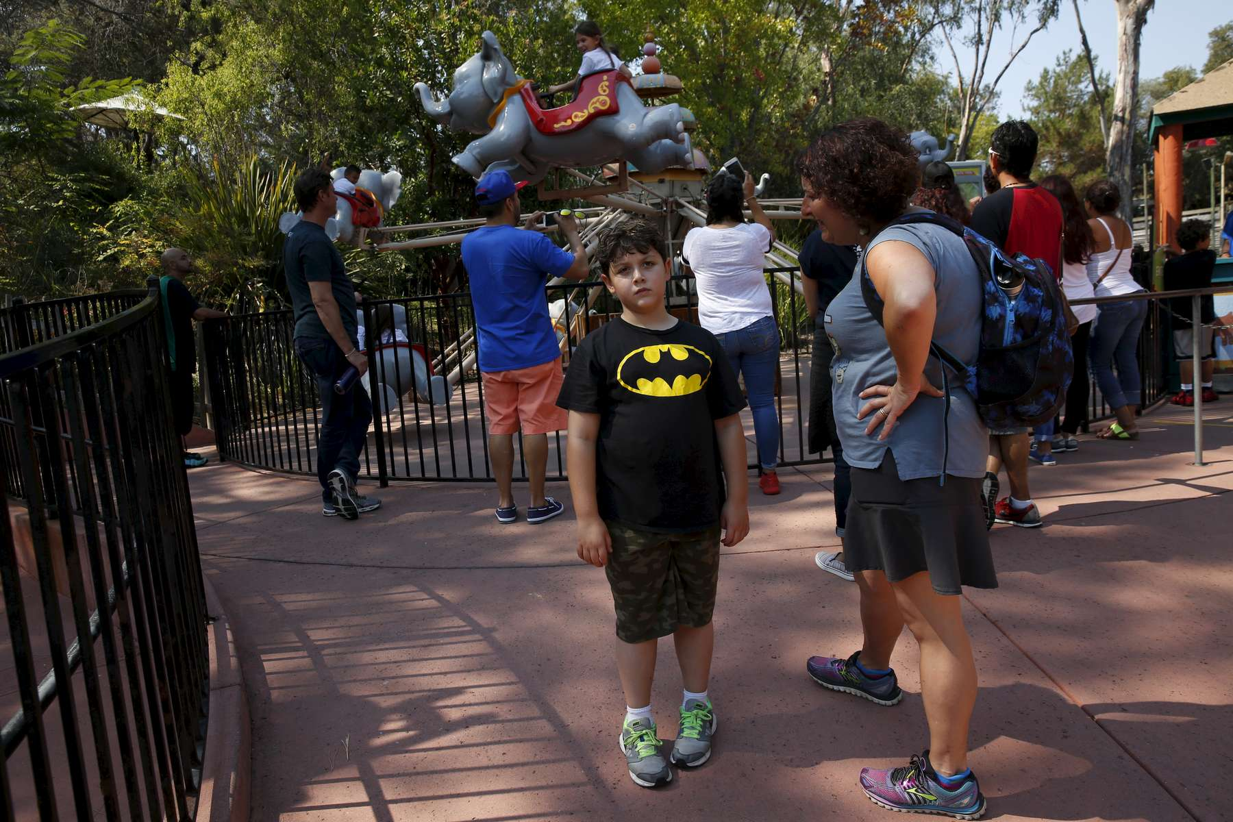 James, 8, expresses his frustration with his mother Sara Kaplan that he is too tall to go on the ride behind him during a family outing to Six Flags amusement park Aug. 20, 2016 in Vallejo, Calif. The prospect of puberty can make James nervous.