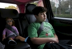 James Kaplan, 9, rides in the car with Brooks buckled in securely next to him with his younger sibling and mother on their way to host a rally for Gavin Grimm Feb. 15, 2017 in Berkeley, Calif. Grimm, a transgender teenager, sued the school board of his Virginia high school for the right to use the bathroom that corresponds with his gender identity. Sara Kaplan organized a rally that was one of many coordinated across the nation in support of Grimm before his case was to be seen by the Supreme Court. Ben, James' father, says that right after he transitioned, James stopped playing with his beloved dolls. It was not until his parents told him that just because he was a boy didn't mean he couldn't play with his dolls that he picked them back up again.