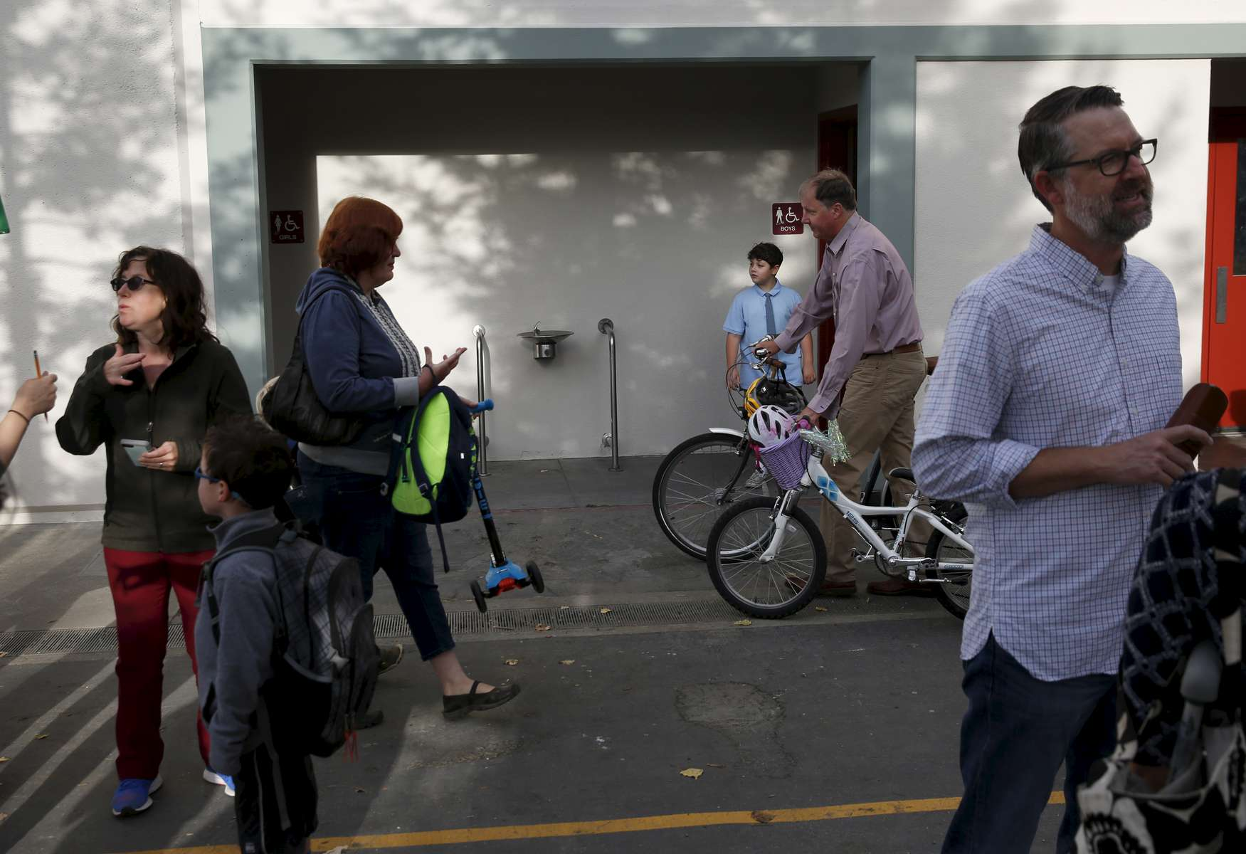 James Kaplan, 8, exits the boy's bathroom while waiting to leave for his first class on the first day of school August 30, 2016 at Malcom X Elementary School in Berkeley, Calif.