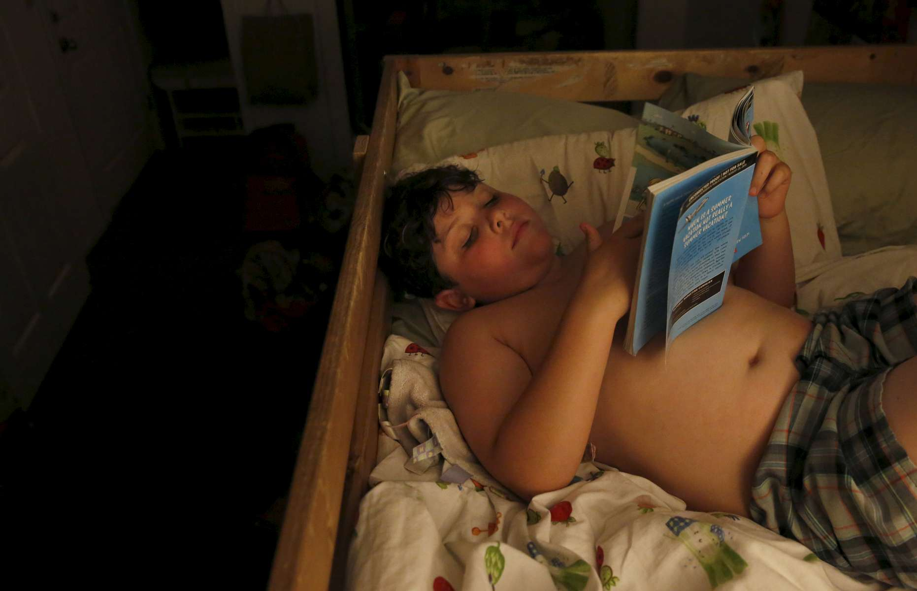 James Kaplan, 8, reads a book for a few minutes before going to sleep Oct. 13, 2016 in Berkeley, Calif. James' father Ben says that right after he transitioned, James became very interested in all of the stereotypical {quote}boy stuff{quote} like batman and comic books. It wasn't until his parents told him it was OK to still like some of the stereotypical {quote}girl things{quote} he still liked from before, like his dolls, that he seemed to level out and feel comfortable having hobbies based on what he liked and not gender stereotypes.