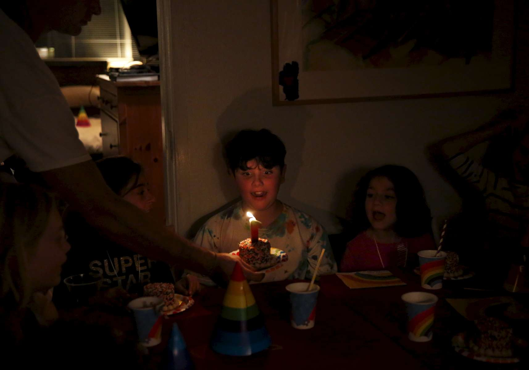 James Kaplan, 9, reacts to his birthday candle and personal cake as everyone sings to him Dec. 1, 2016 during his birthday party in Berkeley, Calif. James counted down the days until his birthday, which he and his mother decided to use the theme of {quote}one year old{quote} to celebrate his first full year living as his true self.