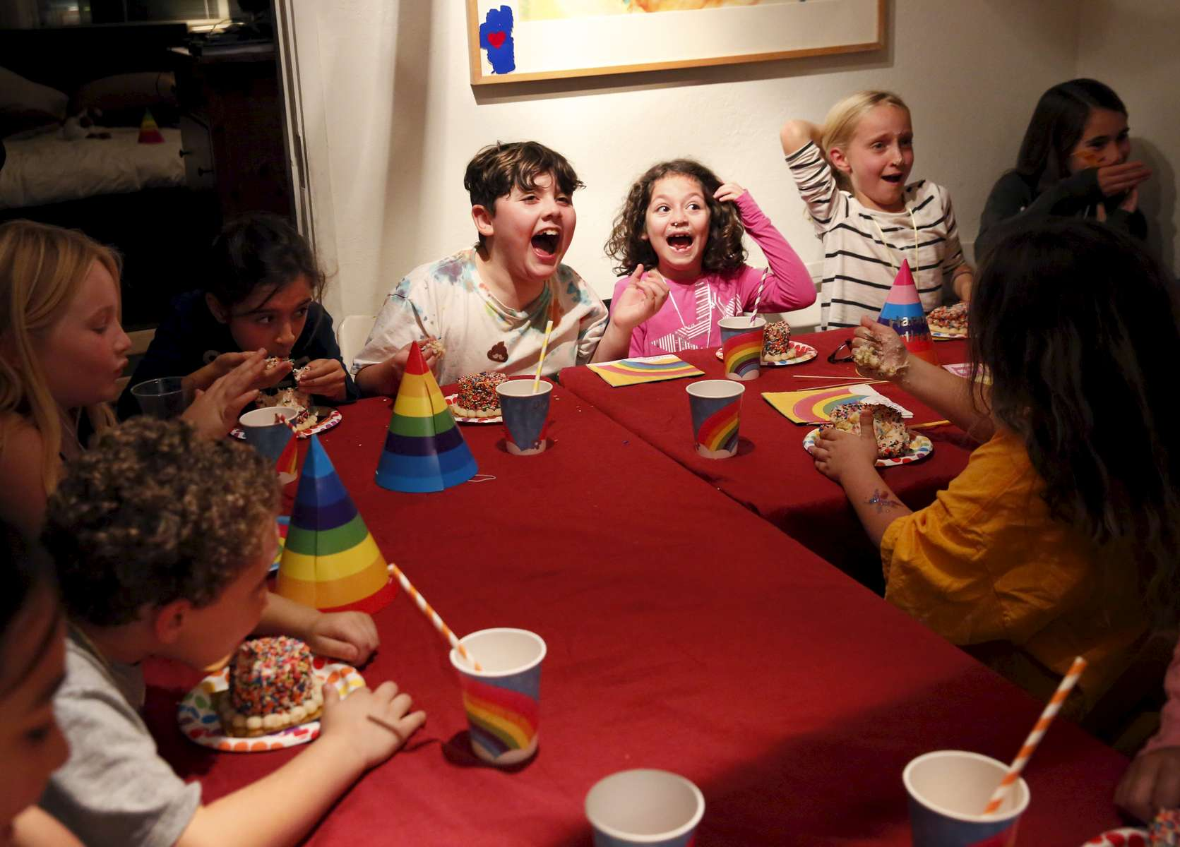 James Kaplan, 9, center, laughs with friends after smashing his face into his cake, from left, Serene Kimball, 8, Simone Zabarsky, 8, Clara, 8, Juna French, 8, and Audrey Malker, 8 Dec. 1, 2016 during his birthday party in Berkeley, Calif. James counted down the days until his birthday, which he and his mother decided to use the theme of {quote}one year old{quote} to celebrate his first full year living as his true self.