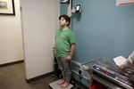 James Kaplan, 9, gets his height measured during an appointment with his pediatric doctor to check on his physical development Dec. 13, 2016 in Berkeley, Calif. Eventually,  James will be put on hormone blockers to stop the effects of puberty until he is a young teen. If he still insists on his current gender identity, he will then be put on cross-hormone therapy which will allow him to experience development that aligns with his gender identity.