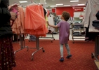 Olivia Kaplan, 4, drifts through the girls' clothing section during a trip to Target to find formal clothes for James Feb. 17, 2017 in Berkeley, Calif. Olivia, James' sibling, had been describing herself as trans for much of the past year since her brother came out as a transgender boy. Sara and Ben decided to brush it off to see if it was just something she was saying to copy her sibling. But it became apparent over time that it was very real to Olivia. She has always been a feminine child and she finally shouted at her parents that she was a girl at the beginning of the year. They cautiously allowed her to begin the transition. As of June, 2017, Olivia is still happily presenting as a girl. Sara and Ben plan on doing what they have for James: provide a supportive space for their children to be themselves whoever they turn out to be later in life.