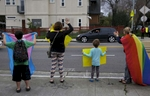 From left, James, 9, Sara and Charley Kaplan, 4, hold signs and cheer with other students and parents at a rally for Gavin Grimm organized by Sara outside of Malcom X Elementary School Feb. 15, 2016 in Berkeley, Calif. Grimm, a transgender teenager, sued the school board of his Virginia high school for the right to use the bathroom that corresponds with his gender identity. Sara Kaplan organized a rally that was one of many coordinated across the nation in support of Grimm before his case was to be seen by the Supreme Court.