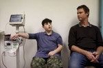 James Kaplan, 9, left, gets his vitals taken while sitting next to his dad Ben Kaplan during a medical appointment to determine if he is starting puberty at UCSF Benioff Children's Hospital's Child and Adolescent Gender Center Clinic March 15, 2017 in Oakland, Calif. James will be put on hormone blockers to stop the effects of puberty until he is a young teen. If he still insists on his current gender identity, he will then be put on cross-hormone therapy which will allow him to experience development that aligns with his gender identity.