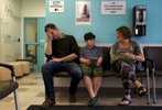 James Kaplan, 9, center, and his father Ben react to a puberty joke made by his mother Sara, right, as they wait for James' medical appointment  to determine if he is starting puberty March 15, 2017 at UCSF Benioff Children's Hospital's Child and Adolescent Gender Center Clinic in Oakland, Calif. James will be put on hormone blockers to stop the effects of puberty until he is a young teen. If he still insists on his current gender identity, he will then be put on cross-hormone therapy which will allow him to experience development that aligns with his gender identity.