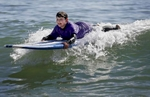 James Kaplan, 8, surfs a wave during a family trip Oct. 9, 1016 sponsored by Focus on Cancer in Santa Cruz, Calif. Sara, who survived kidney cancer, was sponsored by the company which works with cancer patients and survivors and their loved ones to provide support and special trips to reduce social isolation.
