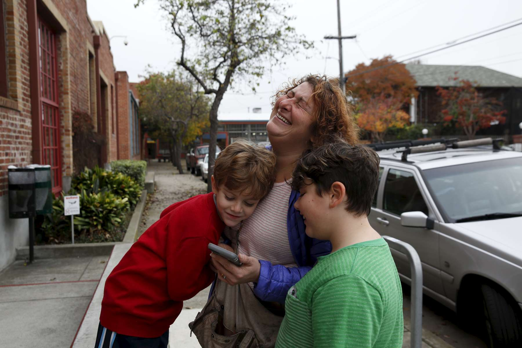 Sara cracks up with her children Charley, 4, left, and James Kaplan, 9, before the two of them went into their play-therapy sessions Dec. 13, 2016 in Berkeley, Calif. Since the reporting of this story, Charley has been living as a girl. She is wearing dresses, growing her hair out and has taken a more feminine name.