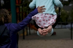Sara Kaplan pushes her daughter Olivia, 5, on the swing as Olivia and James play in the park while they wait to get haircuts June 3, 2017 in Berkeley, Calif. Olivia, James' sibling, had been describing herself as trans for much of the past year since her brother came out as a transgender boy. Sara and Ben decided to brush it off to see if it was just something she was saying to copy her sibling. But it became apparent over time that it was very real to Olivia. She has always been a feminine child and she finally shouted at her parents that she was a girl at the beginning of the year. They cautiously allowed her to begin the transition. As of June, 2017, Olivia is still happily presenting as a girl. Sara and Ben plan on doing what they have for James: provide a supportive space for their children to be themselves whoever they turn out to be later in life.