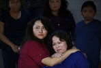 With tears in her eyes, Vianney Sanchez, 23, left, comforts her mother Maria Mendoza-Sanchez after a meeting the family had with Sen. Dianne Feinstein at the Sanchez home as siblings, from left, Melin Sanchez, 21, Elizabeth Sanchez, 16, and Jesus Sanchez, 12 look on August 10, 2017 in Oakland, Calif.