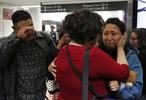 Maria Mendoza-Sanchez says her final words of good bye while holding her daughter Melin, 21, as her husband Eusebio tries to keep his composure as they leave for their self-deportation flight back to Mexico from San Francisco International Airport August 16, 2017 in San Francisco, Calif.