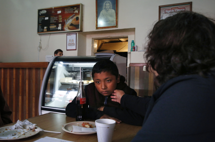 Maria Mendoza-Sanchez gently touches her son Jesus, 12, on the chin while talking to him about the food he didn't finish during a government tour given to the Chronicle of various sights around Hidalgo Sept. 29, 2017 in Mexico. Maria says that Jesus is a selective eater and had trouble adjusting to constant Mexican food.