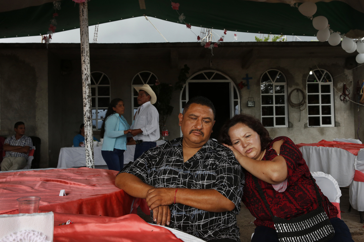 Maria Mendoza-Sanchez leans on her husband Eusebio Sanchez during a family christening party Sept. 28, 2017 near Santa Monica in Hidalgo, Mexico. Maria says family gatherings are bitter-sweet because she hasn't seen or even met many of them but they remind her that she is separated from her children.
