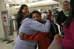 Vianney Sanchez, 23, hugs her little brother Jesus Sanchez, 12, after he arrived from Mexico in the Oakland International Airport as their sisters Elizabeth, 16, left, and Melin, 21, stand nearby Oct. 14, 2017 in Oakland, Calif. Their mother Maria Mendoza-Sanchez made the decision to send him back to the US after it was discovered that his paperwork hadn't gone through quickly enough for school and he would have to repeat the entire grade over again.