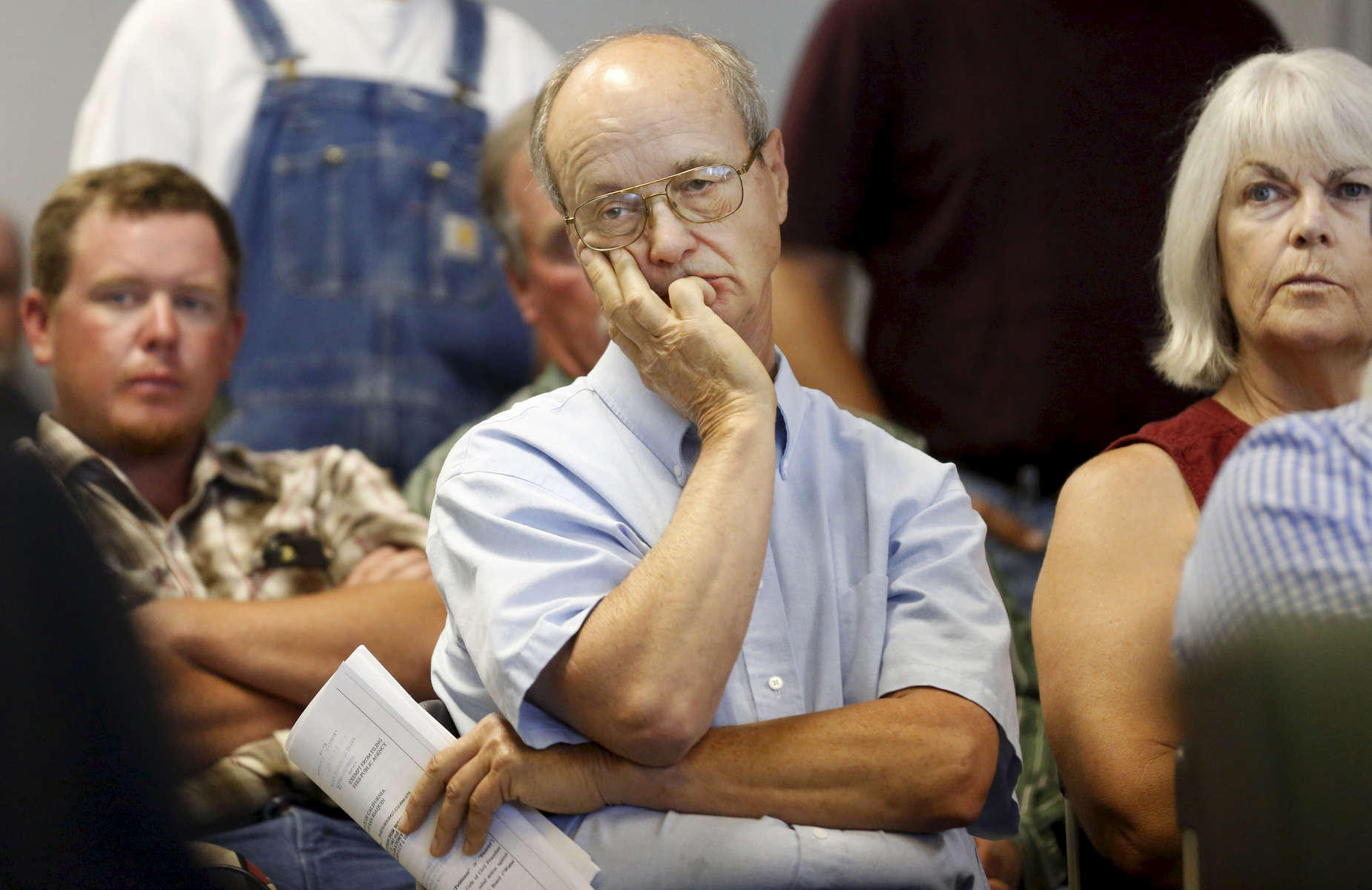 Farmer Glenn Roberston listens to arguments during a hearing between the State Water Board and the Banta-Carbona Irrigation District June 23, 2015 in Stockton, Calif. The hearing was expected to determine whether the state water board can legally stop diversions in the water district, which would threaten the water supply of hundreds of farmers.