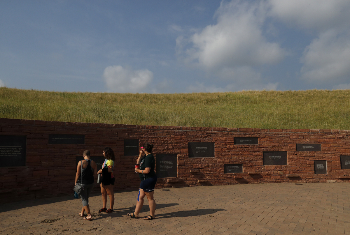Mass shooting survivors, from left, Hayley Steinmuller, of Route 91, Las Vegas, Ellen Davis of Route 91 Las Vegas and Michelle Wheeler of Columbine take in the Columbine memorial during the annual survivor's gathering with The Rebels Project July 28, 2018 in Littleton, Colorado, US.