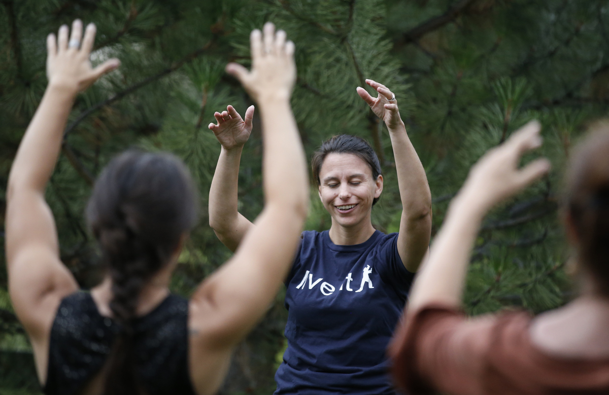 Kim Woodruff, a survivor of the Columbine shooting, teaches a tai chi class to fellow survivors during the family dinner portion of the annual survivor's gathering with The Rebels Project July 28, 2018 in Parker, Colorado, US.