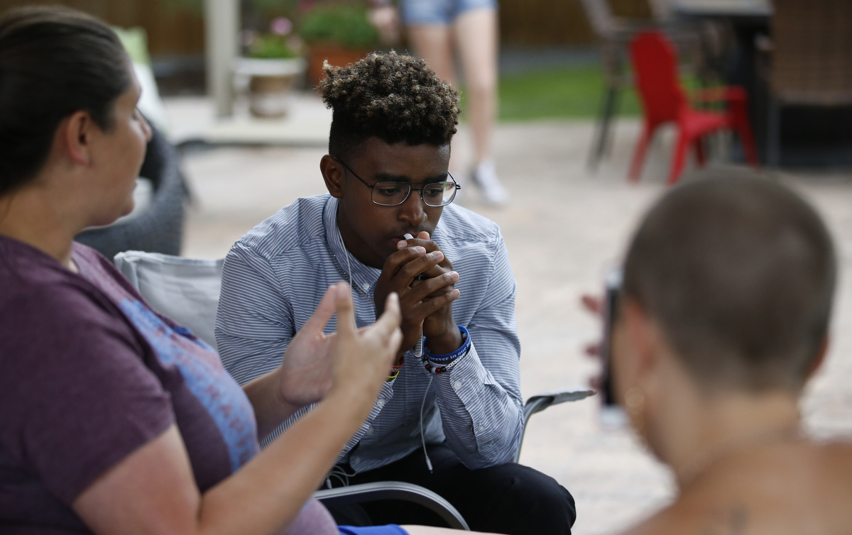 Mass shooting survivors Chad Williams, 18, center, and Michelle Wheeler, left, of Columbine, share stories about their experiences during the family dinner portion of the annual survivor's gathering with The Rebels Project July 28, 2018 in Parker, Colorado, US.