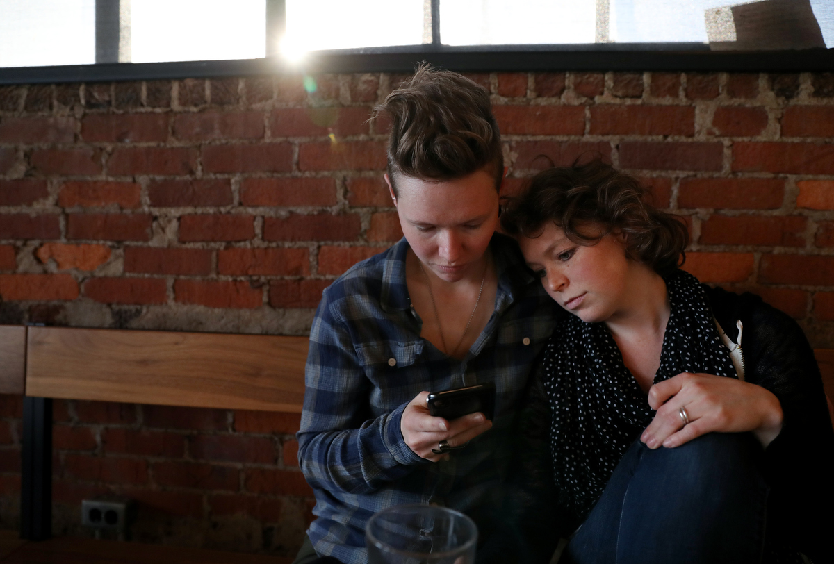 Chelsea Sobolik, a survivor of the Aurora Theater shooting, right, hangs out with her partner Liza Holbrook, March 11, 2019 in a cafe in Nashville, TN, US. Sobolik is one of the leadership team members of The Rebels project.