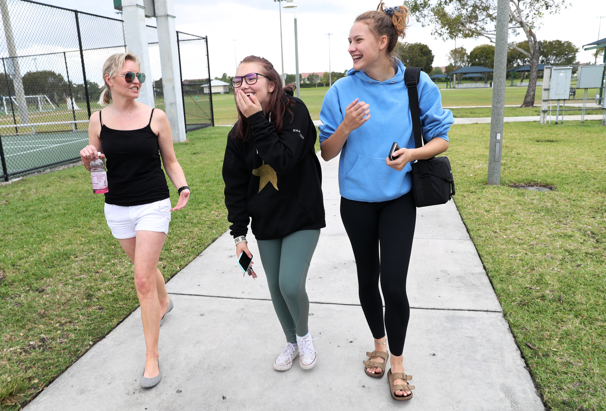 Heather Martin, who survived the shooting at Columbine high school nearly 20 years ago, chats with Ava Steil, 16, center, and Brianna Jesionowski, 16, April 2, 2019, both students survived the Marjory Stoneman Douglas shooting last year, in Parkland, Florida, US. The Rebels Project members were invited to Florida to participate in a Parkland MSD Community Peer Support Event. The students interviewed Martin along with two other The Rebels Project members for their student paper.