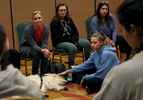 Heather Martin, left, who survived the shooting at Columbine high school nearly 20 years ago, leads a support session for students from Marjory Stoneman Douglas, from left of Martin, Ava Steil, 16, Hayley Siegel, 18, and Brianna Jesionowski, 16, during a Parkland MSD Community Peer Support Event April 2, 2019 in Coral Springs, Florida, US.