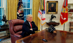 U.S. President Donald Trump looks down at a reporter's phone on his desk that is recording his words during an interview with Reuters in the Oval Office of the White House in Washington, U.S. August 20, 2018.  REUTERS/Leah Millis