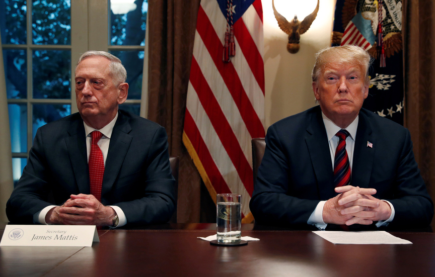U.S. President Donald Trump speaks to the news media while gathering for a briefing from his senior military leaders, including Defense Secretary James Mattis (L), in the Cabinet Room at the White House in Washington, U.S., October 23, 2018. REUTERS/Leah Millis