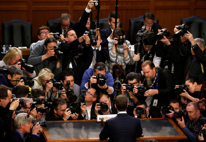 Facebook CEO Mark Zuckerberg is surrounded by members of the media as he arrives to testify before a Senate Judiciary and Commerce Committees joint hearing regarding the company's use and protection of user data, on Capitol Hill in Washington, U.S., April 10, 2018. REUTERS/Leah Millis     TPX IMAGES OF THE DAY