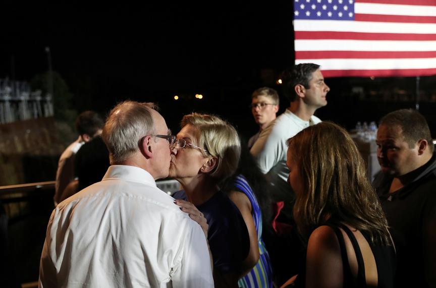 Democratic presidential candidate Sen. Elizabeth Warren kisses her husband Bruce Mann after finishing her speech during Jim Clyburn's World Famous Fish Fry in Columbia, South Carolina, U.S., June 21, 2019.