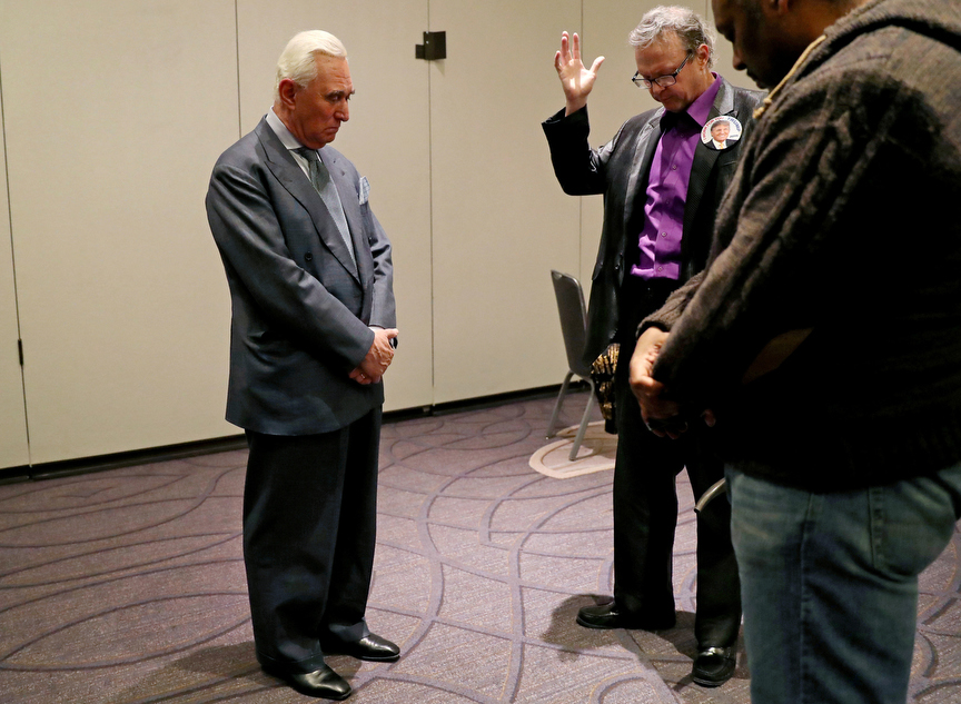 Johnny Rice and Dr. Randy Lancaster Short pray over Roger Stone, longtime ally of U.S. President Donald Trump, after he appeared for a press conference and interviews with media in Washington, U.S., January 31, 2019. Stone was indicted on seven-counts connected with Mueller's probe into potential Russian meddling in the 2016 U.S. presidential election and the Trump campaign's possible involvement.