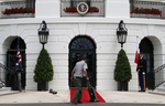 A worker vacuums the red carpet ahead of the arrival of Poland's President Andrzej Duda and his wife, Agata Kornhauser-Duda at the White House in Washington, U.S., June 12, 2019.