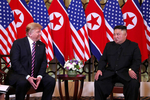 U.S. President Donald Trump and North Korean leader Kim Jong Un sit down before their one-on-one chat during the second U.S.-North Korea summit at the Metropole Hotel in Hanoi, Vietnam February 27, 2019.